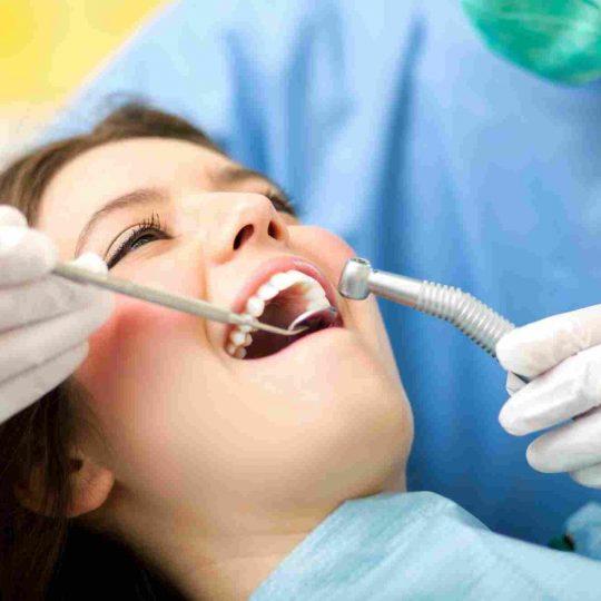 female dental patient receiving dental care